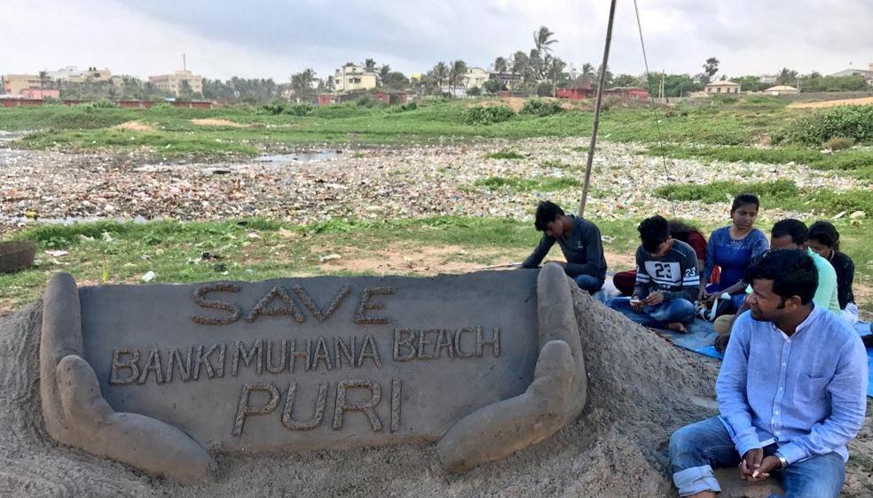 Sudarsan seats on dharana against beach pollution